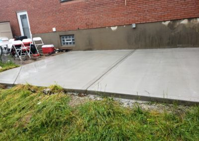 Nick of Delhi Is Very Pleased With His New Concrete Patio Behind His Home! See Pics…